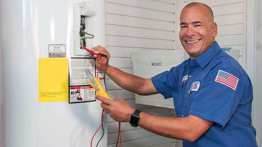 uniformed water heater service contractor smiling at camera