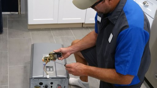 water heater service pro contractor fixes wires of water heater